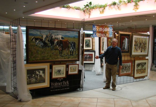 John (husband) at one of the entrances,& the big Nguni painting that sold on the last day.